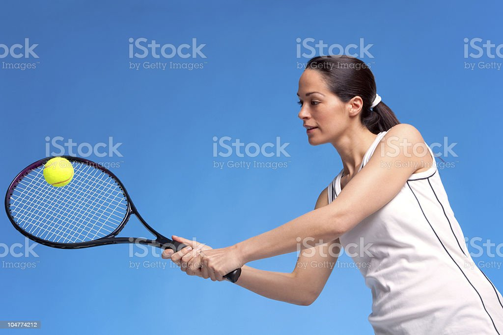 Woman playing tennis forehand shot royalty-free stock photo