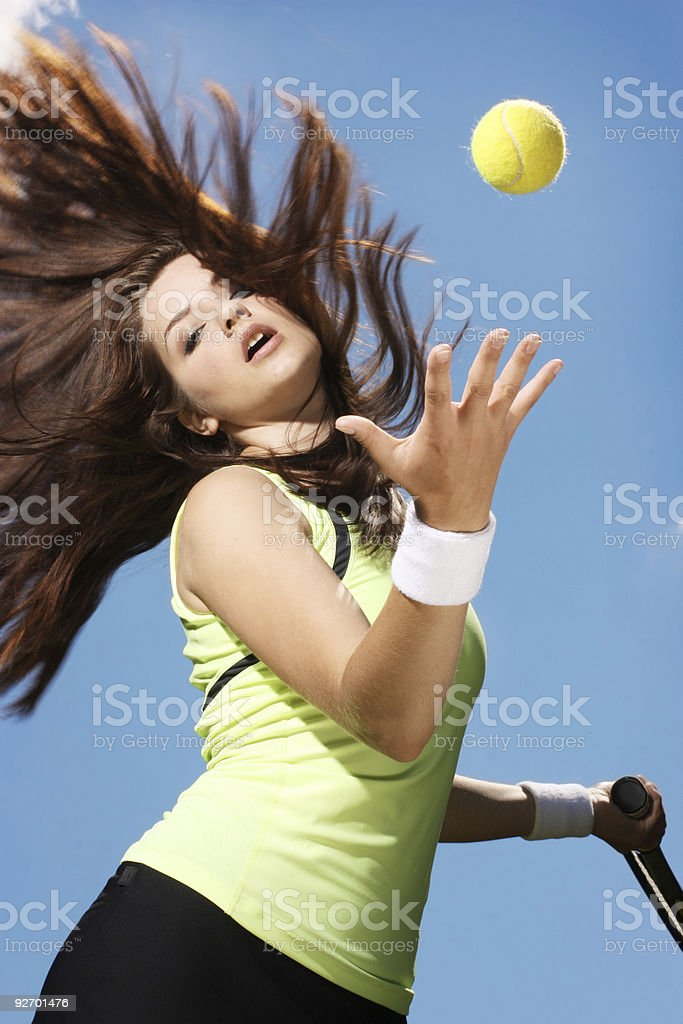 Woman playing tennis royalty-free stock photo