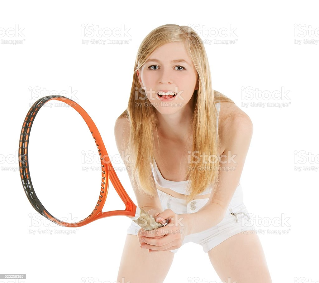 Woman playing tennis waiting ball over white stock photo
