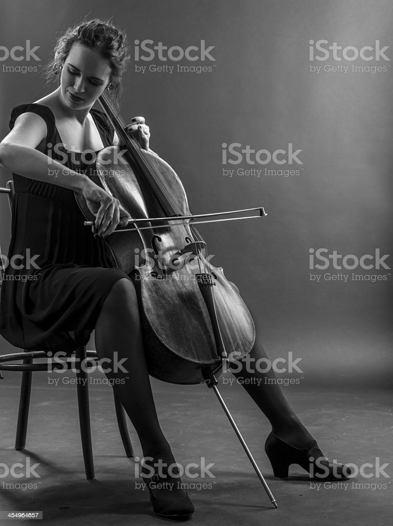 Woman playing the cello black and white stock photo