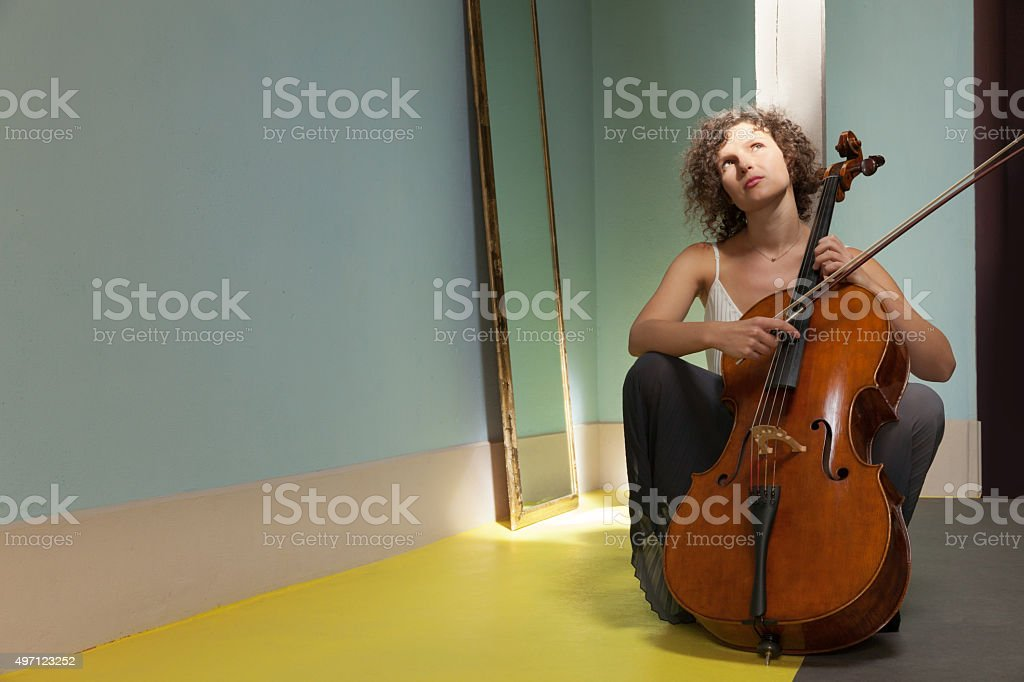 woman playing the cello stock photo