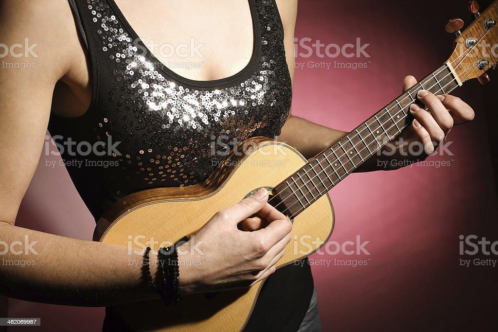 Woman playing the ukulele royalty-free stock photo