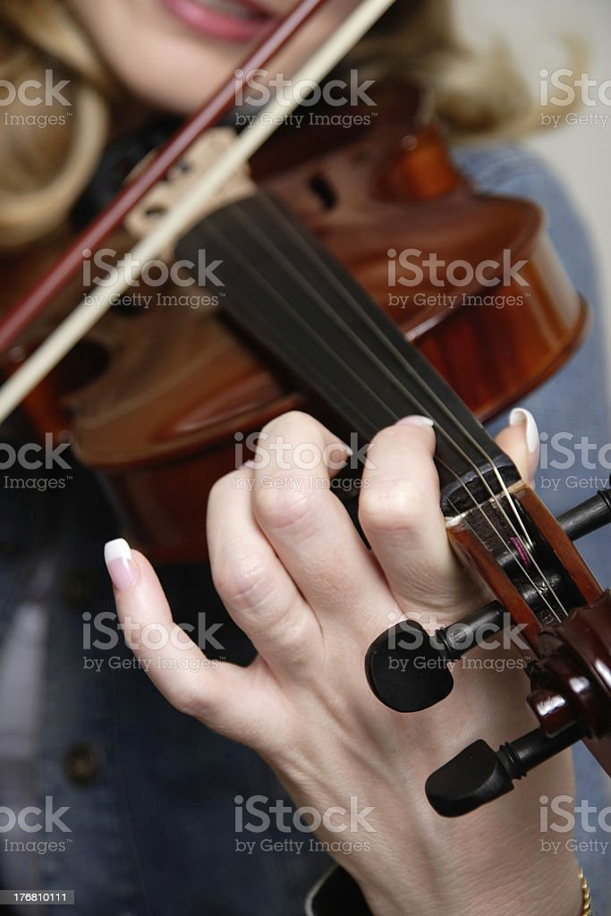 Woman playing the violin royalty-free stock photo