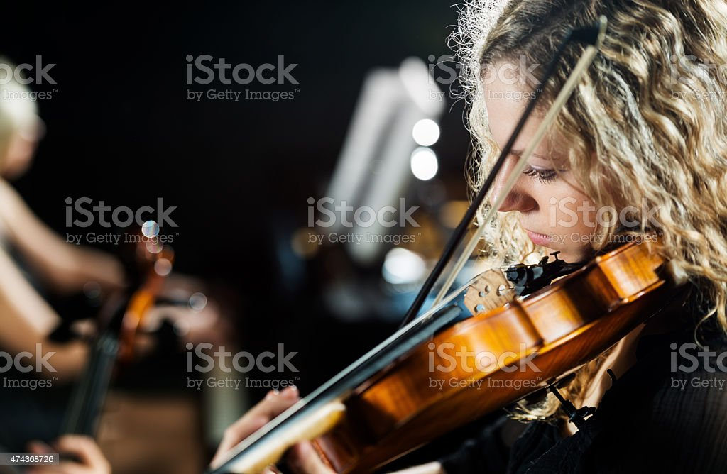 Woman playing the violin. stock photo