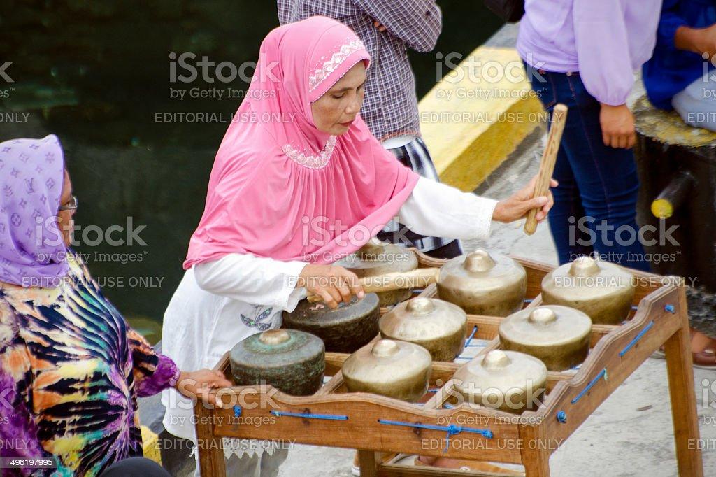 woman playing totobuang stock photo