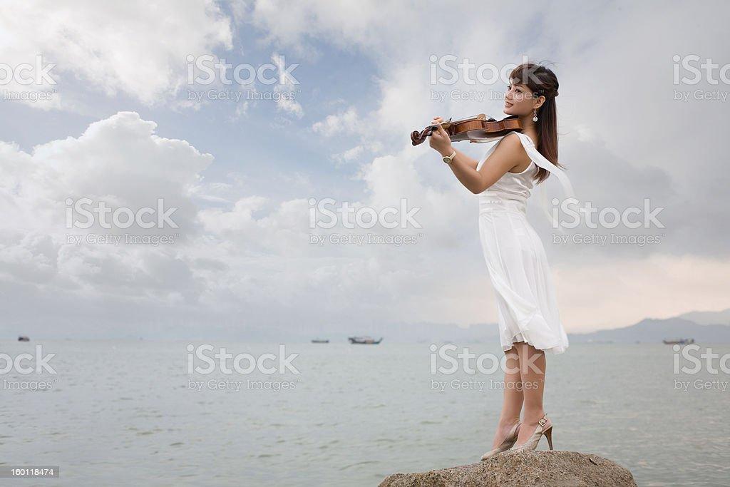 Woman playing violin stock photo