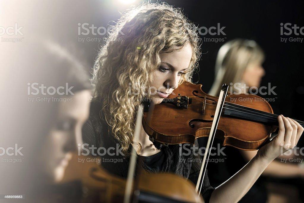 Woman playing violin. stock photo