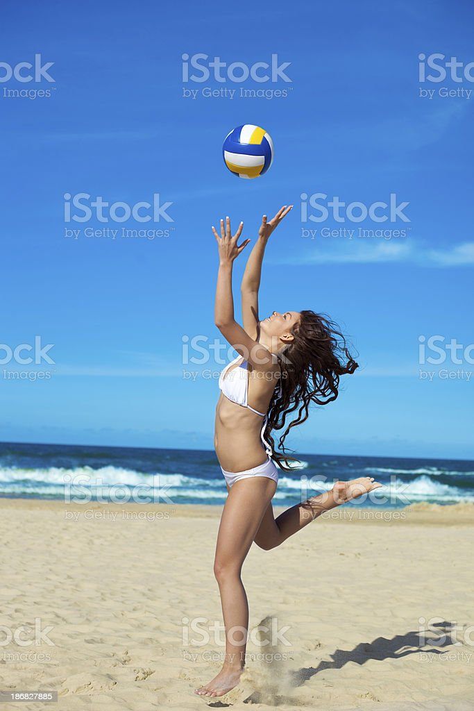 Woman playing volleyball royalty-free stock photo