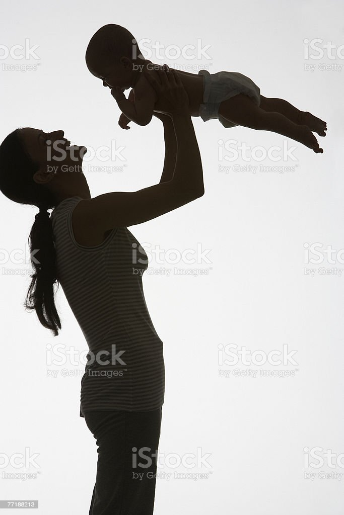 A woman playing with a baby royalty-free stock photo