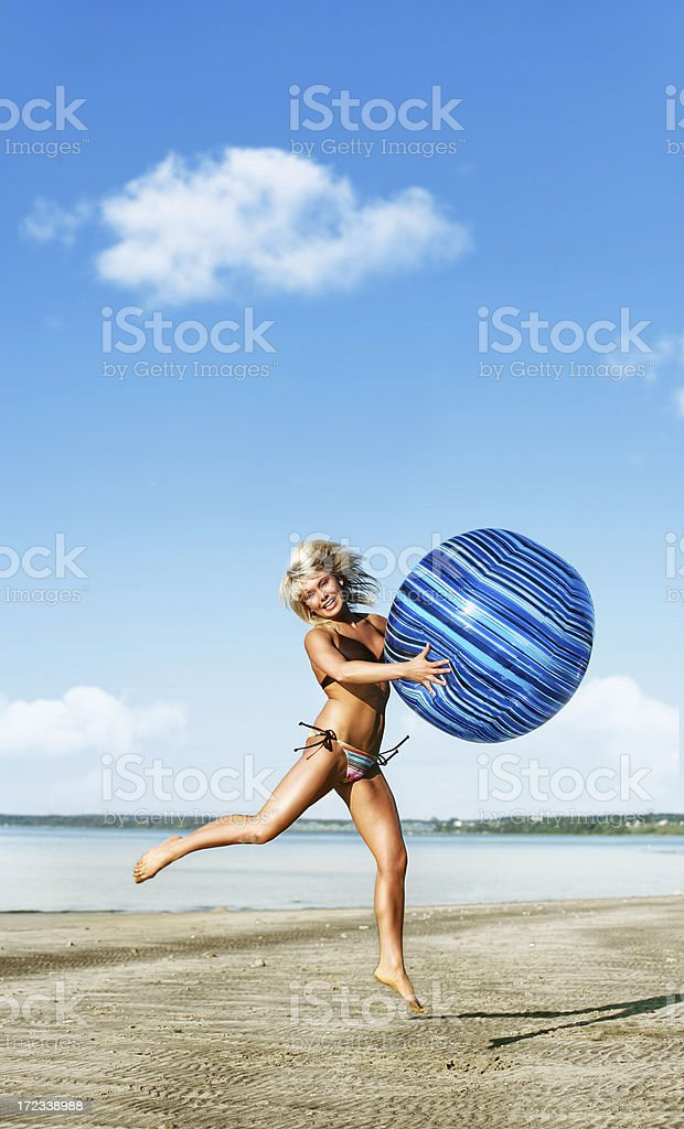 Woman  playing with a Beach Ball royalty-free stock photo