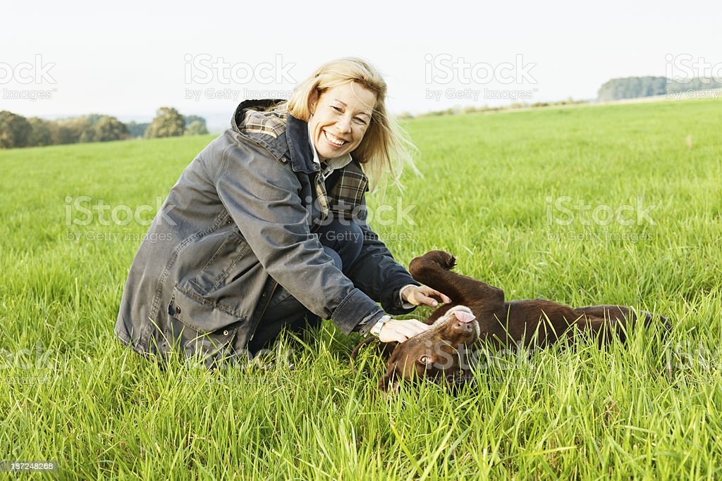 woman playing  with dog healthy lifestyle royalty-free stock photo