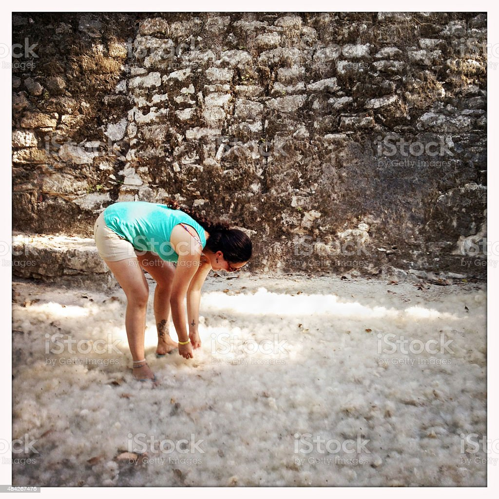 Woman playing with fluffy Kapuk Ceiba seeds Mexico stock photo