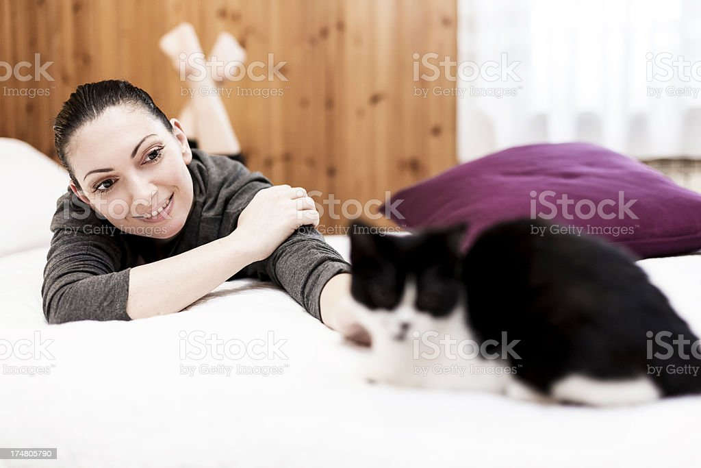 Woman playing with her Cat royalty-free stock photo