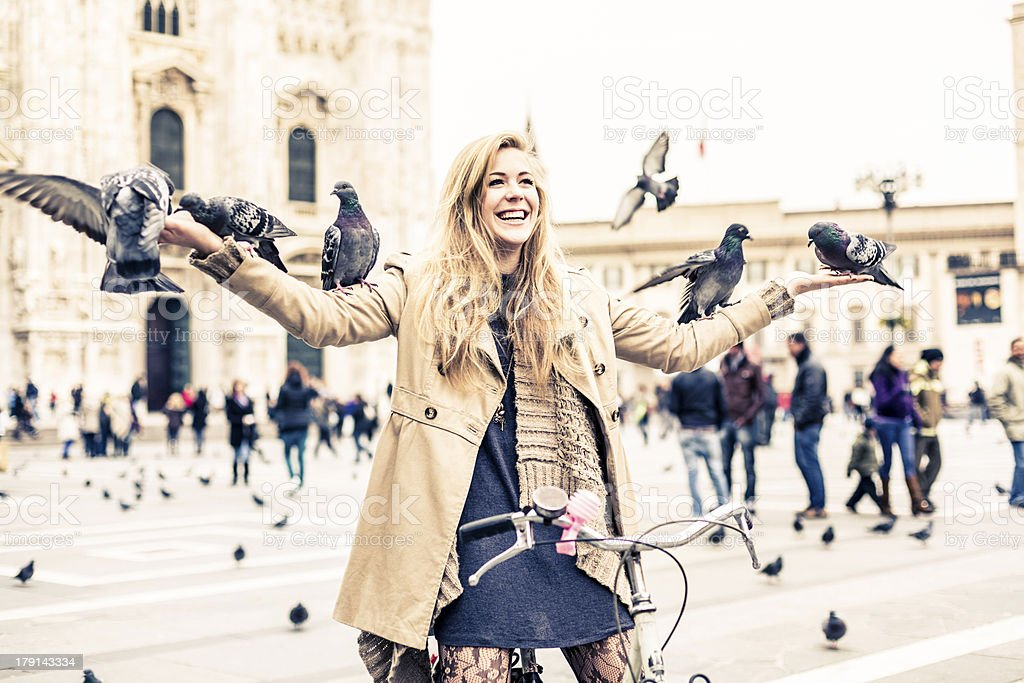 Woman playing with Pigeons royalty-free stock photo