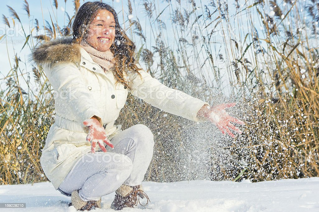 Woman playing with snow royalty-free stock photo