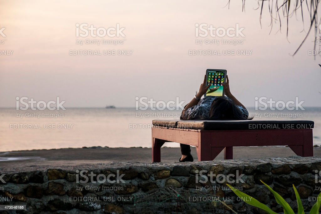Woman playing with tablet stock photo