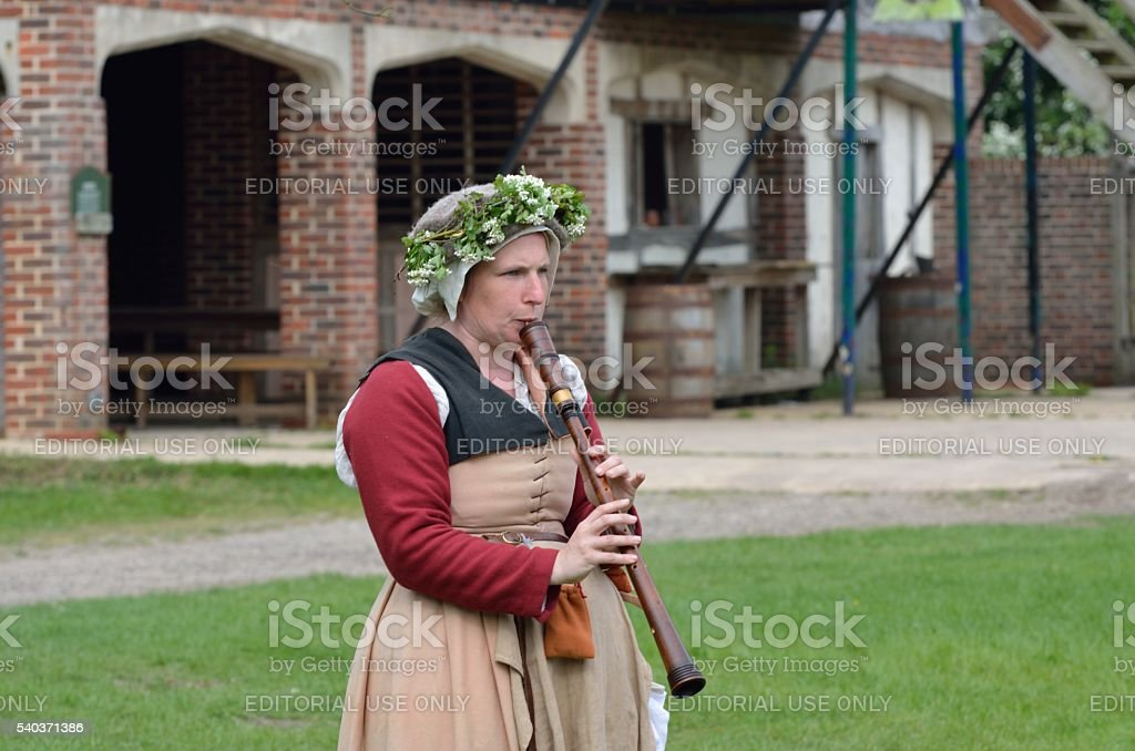 Woman playing wooden flute stock photo