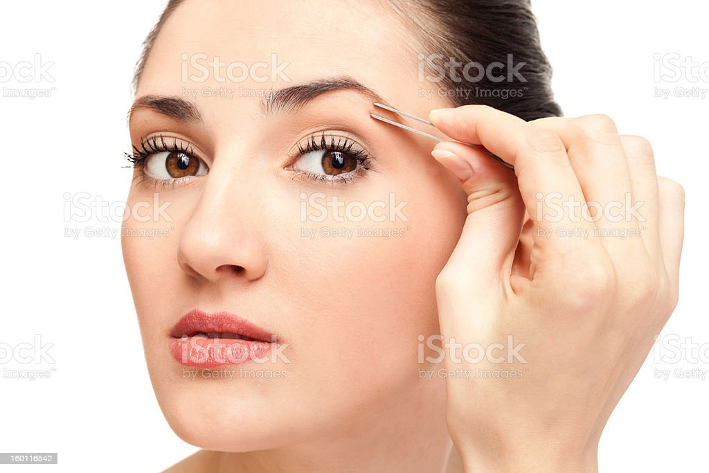 woman plucking eyebrow tweezers stock photo