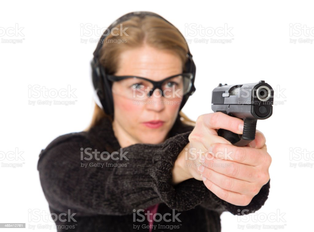 Woman Pointing a Gun on White Background royalty-free stock photo