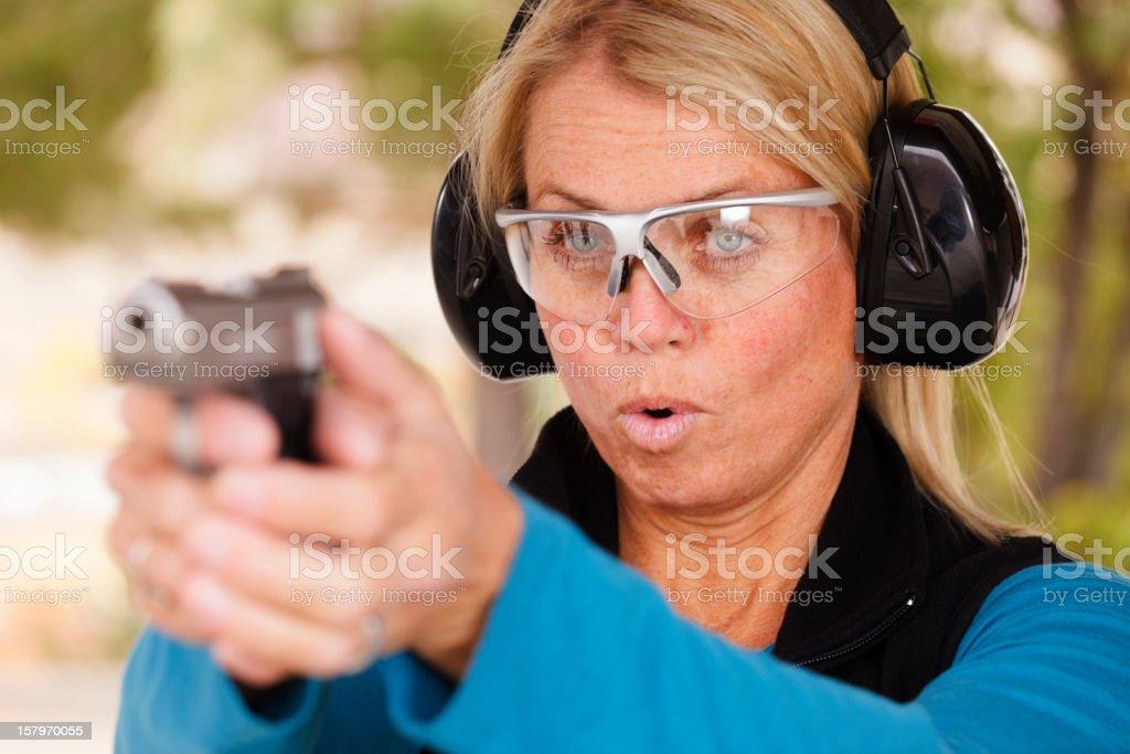 Woman Pointing a Gun stock photo