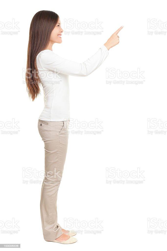 Woman pointing at copy space stock photo