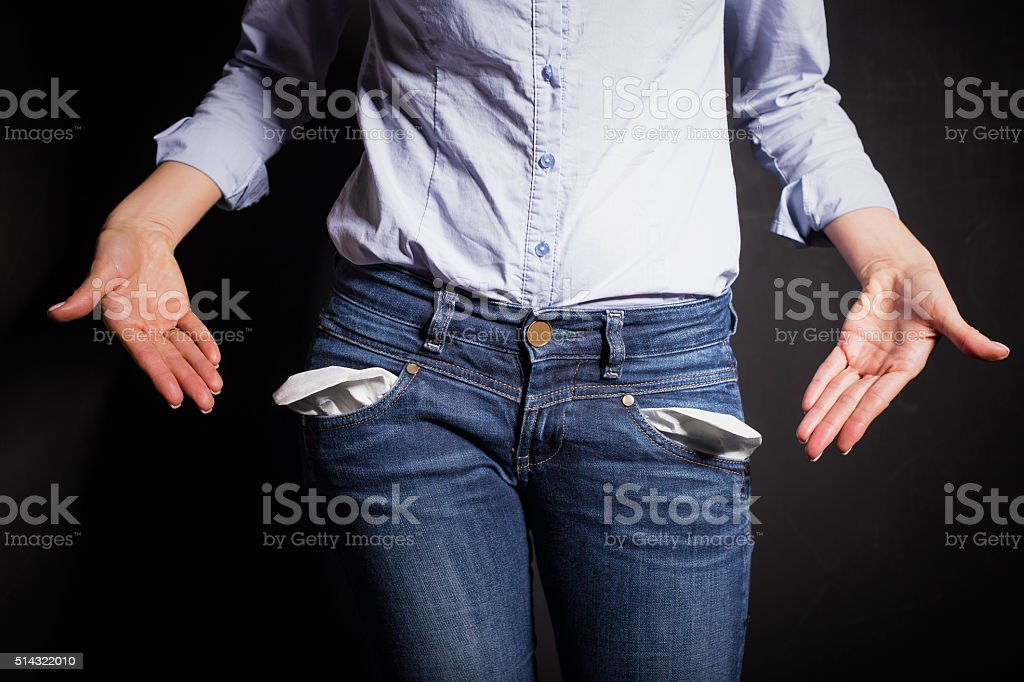 Woman pointing at her pants and showing empty pockets stock photo