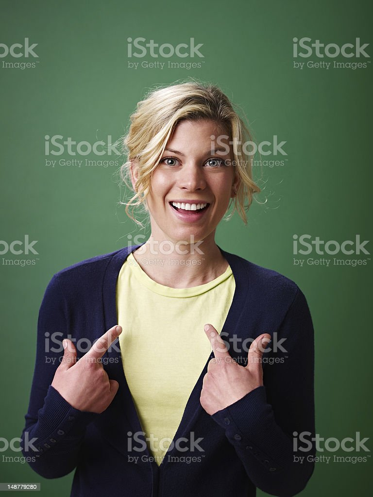 woman pointing at herself, studio shot royalty-free stock photo
