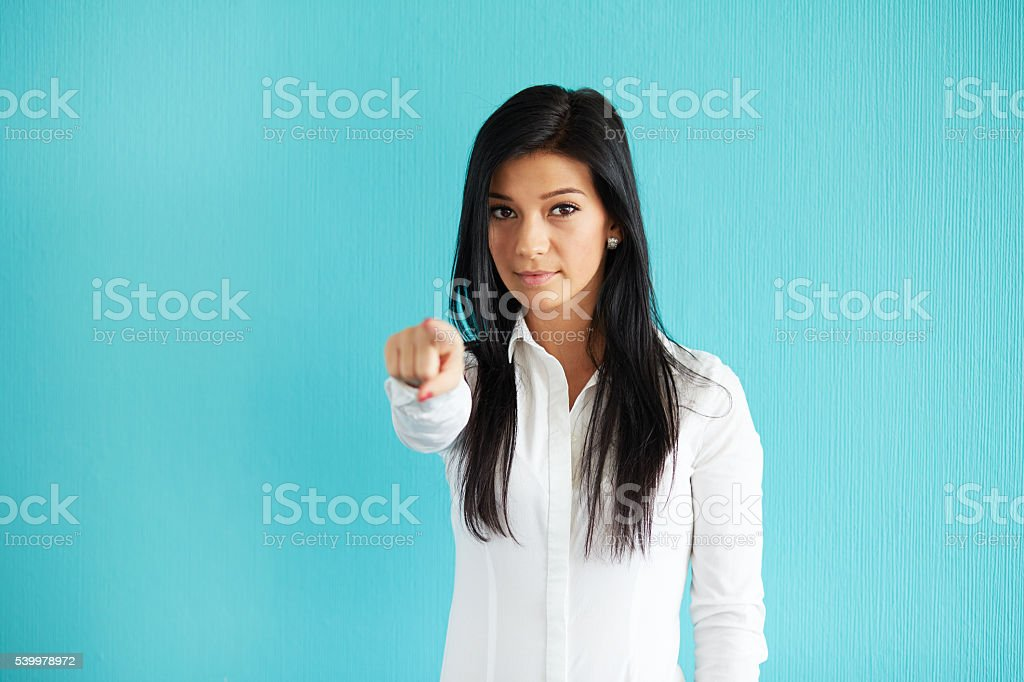 Woman pointing at you stock photo