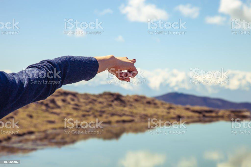 Woman pointing forward in mountain royalty-free stock photo