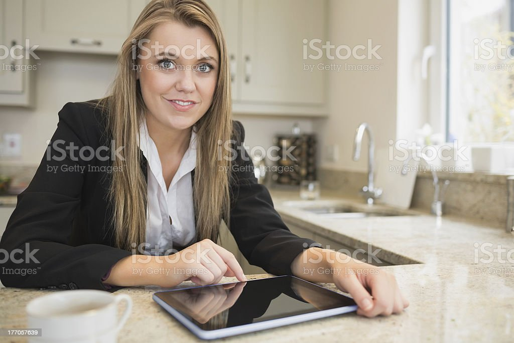 Woman pointing on her tablet pc royalty-free stock photo