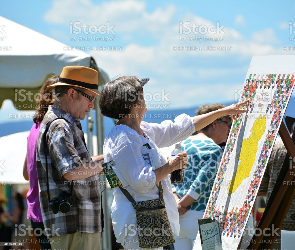 Woman pointing out Irish Heritage on map stock photo