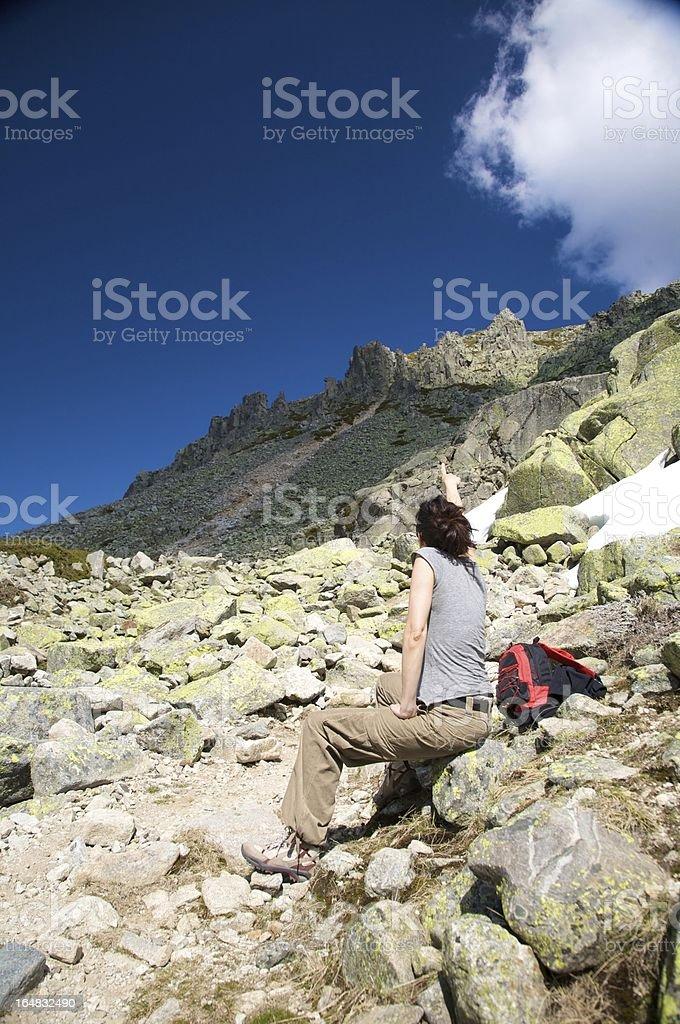 woman pointing peak royalty-free stock photo