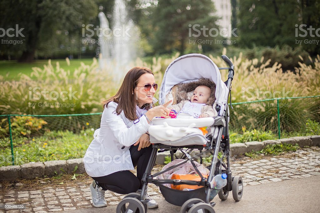 Woman pointing something to her baby stock photo