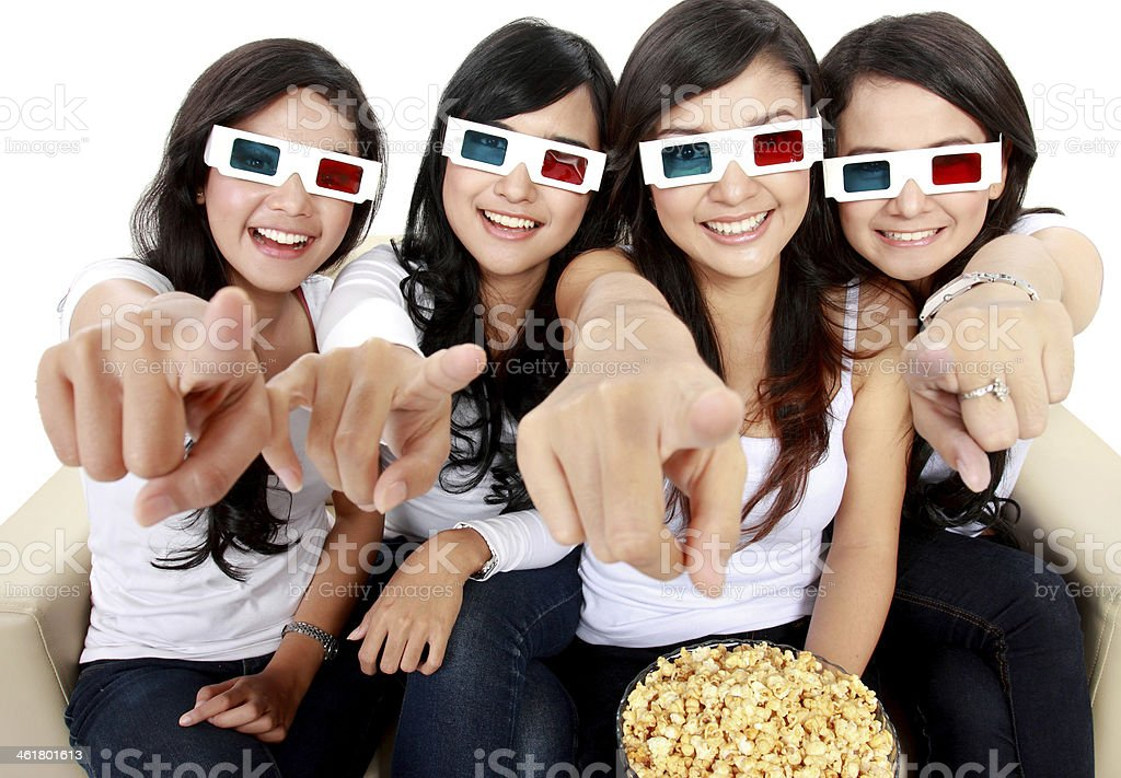 woman pointing to TV while watching 3d movie stock photo