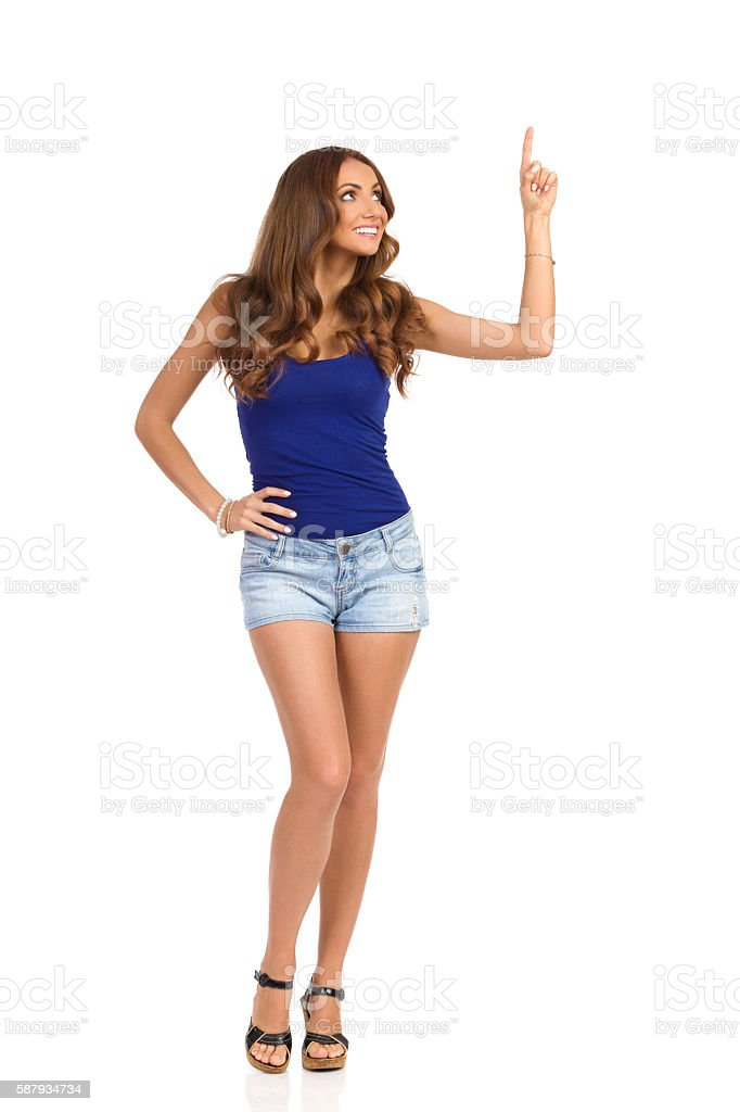 Woman Pointing Up Full Length stock photo