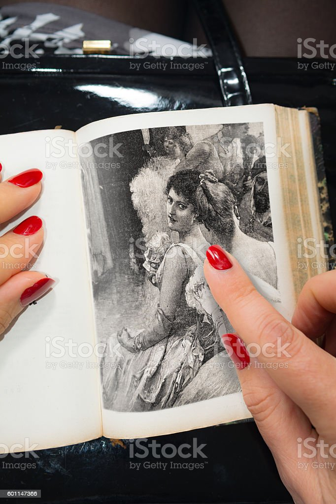 Woman points at a vintage woman visiting a ball stock photo