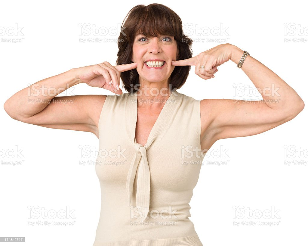 Woman Points At Cheesy Grin royalty-free stock photo