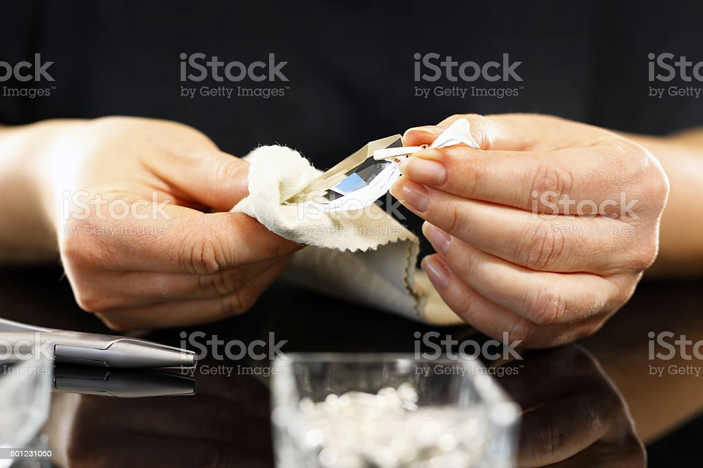 woman polishes the crystal cloth stock photo