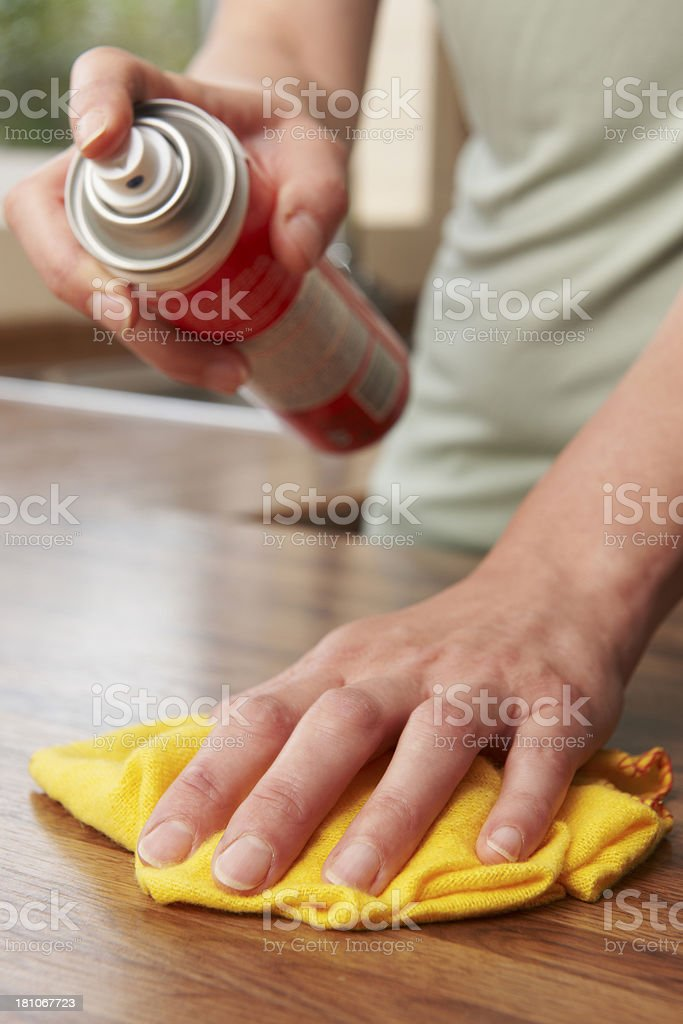 Woman Polishing Wooden Surface With Duster royalty-free stock photo