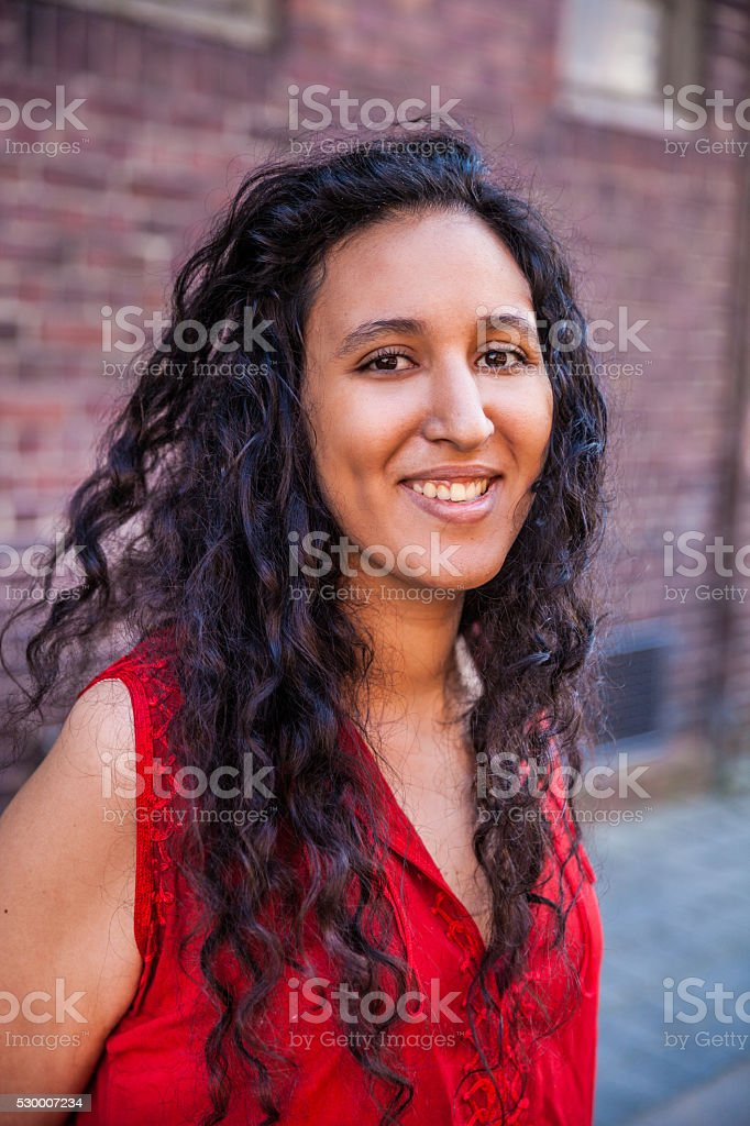 Woman portrait against a brick wall stock photo