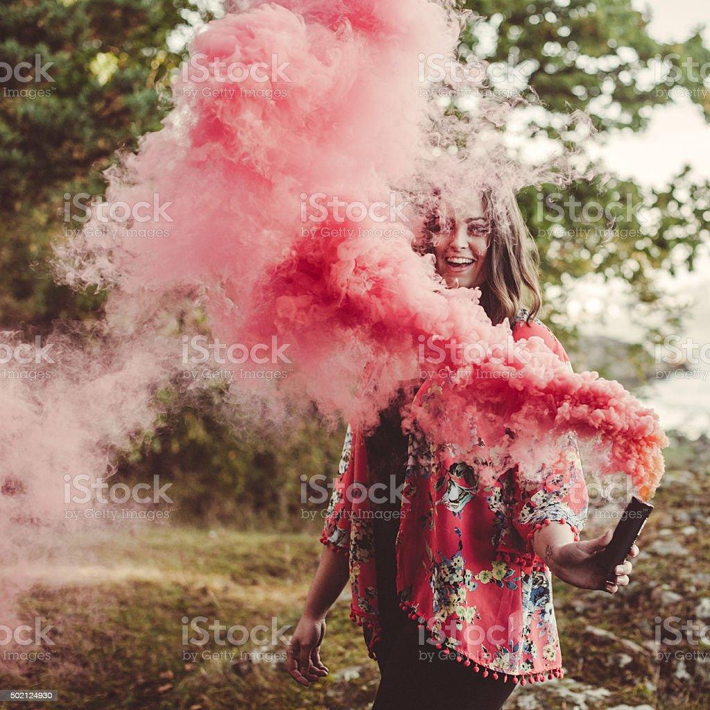 Woman portrait in red smoke stock photo