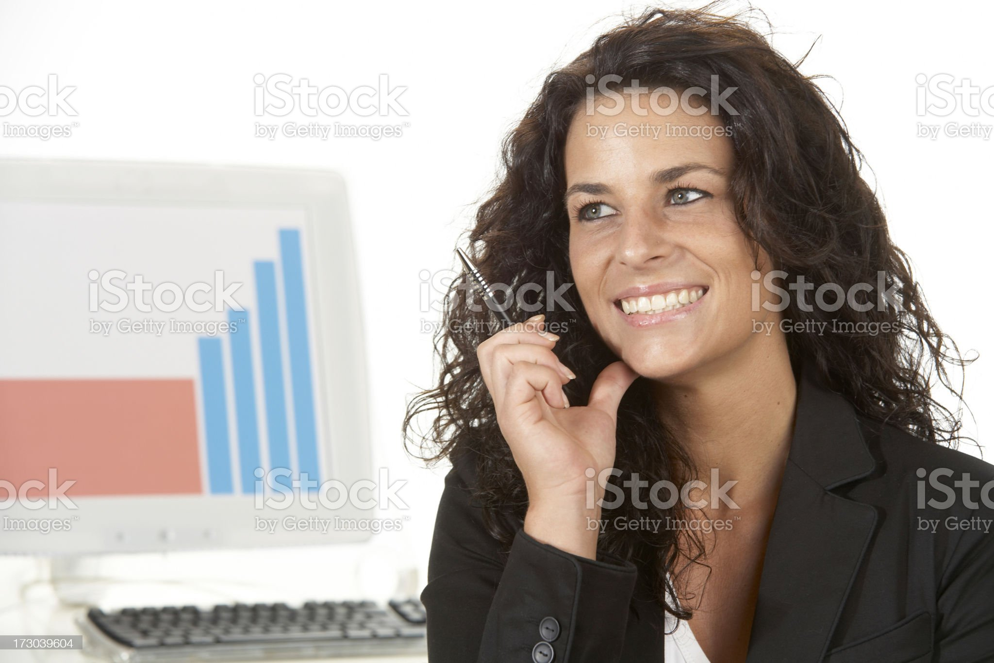 Woman portrait in the office, smiling and thinking royalty-free stock photo