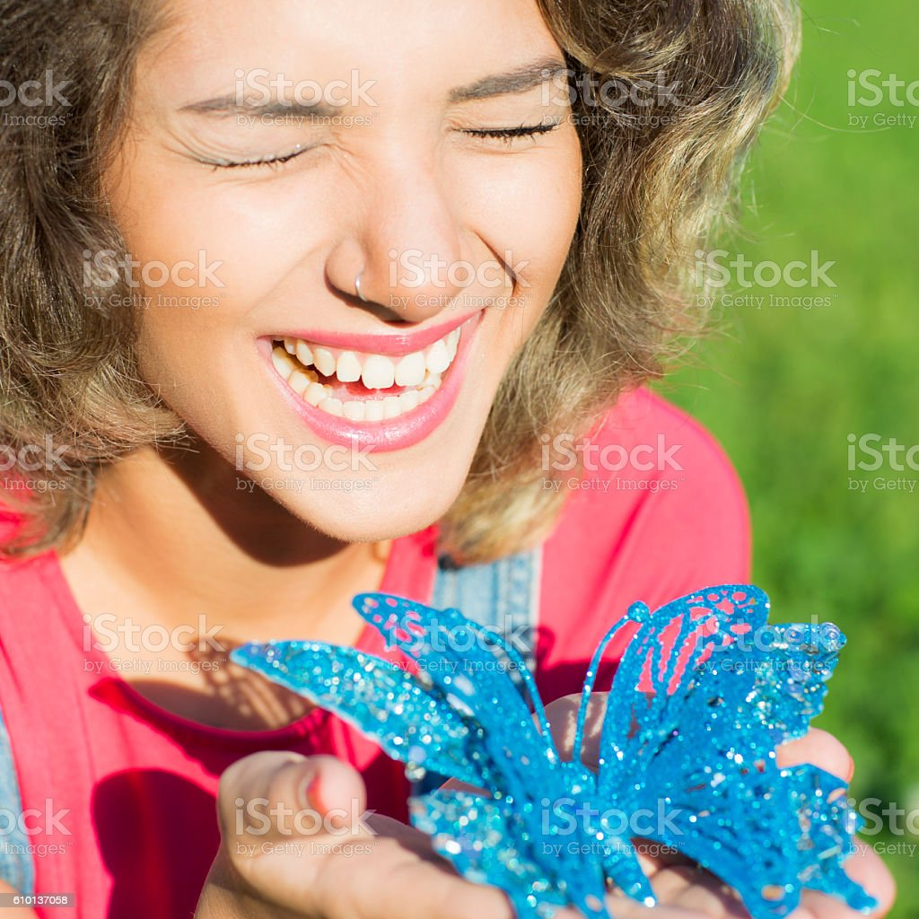 Woman portrait is with a Christmas butterfly. stock photo