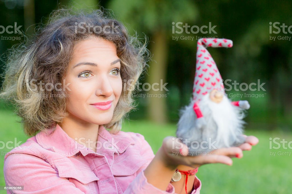 Woman portrait is with a Christmas toy. stock photo