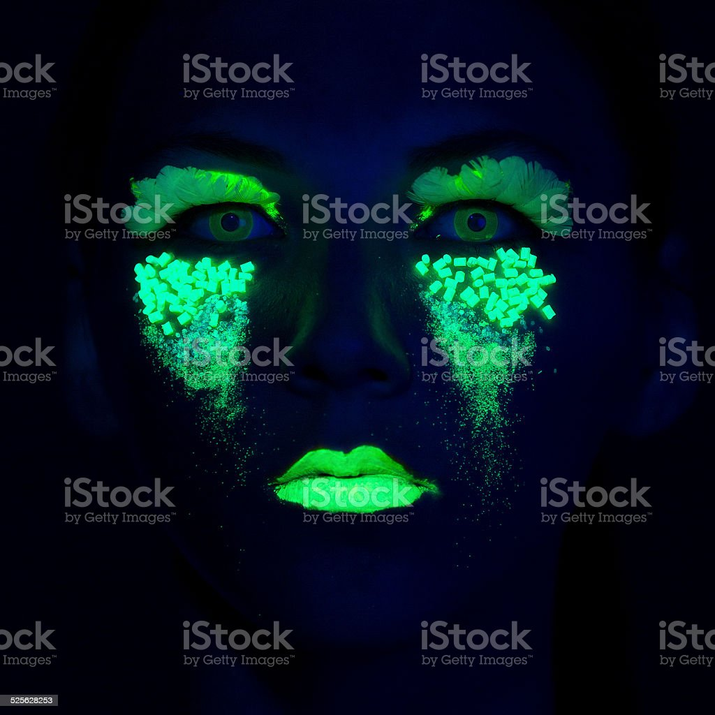 Woman Portrait painted with UV makeup color stock photo