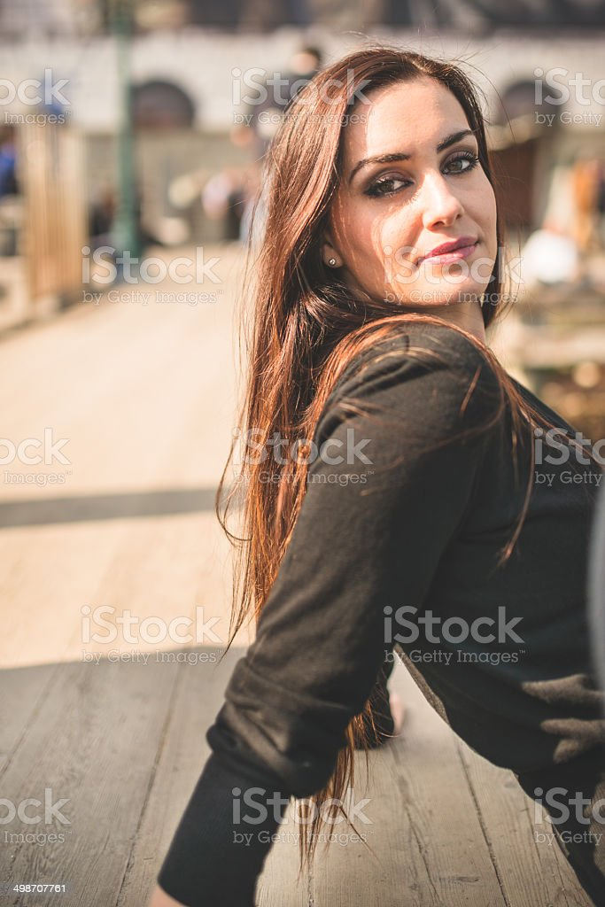 woman portrait sitting on the pier royalty-free stock photo