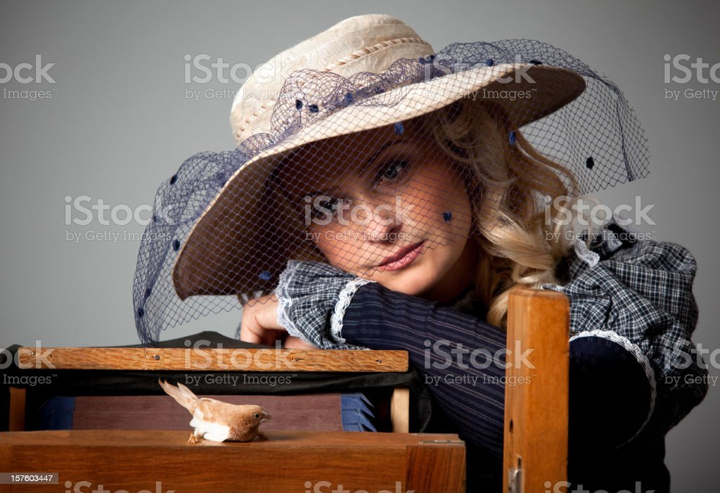 Woman portrait with a bird royalty-free stock photo