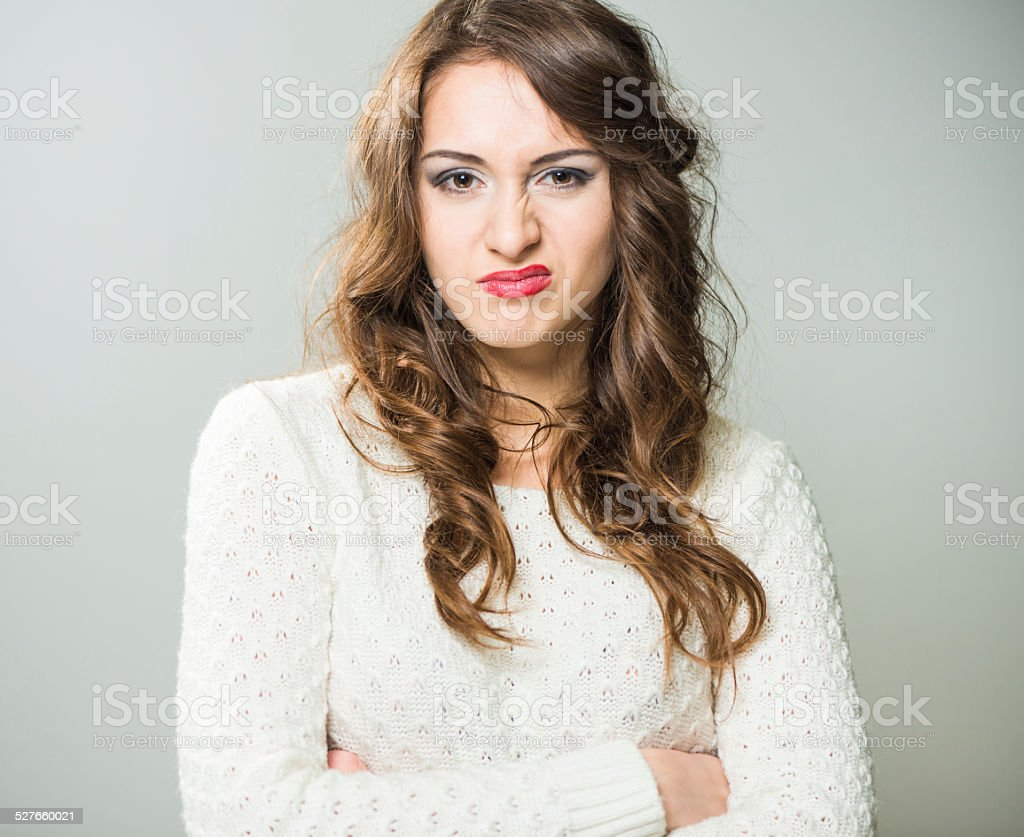 woman portrait with disgust face stock photo