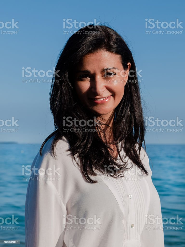 Woman posing for a photo in the beach stock photo
