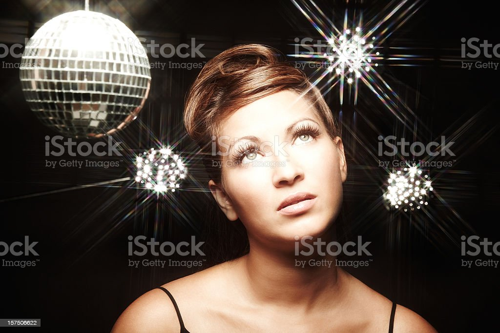 Woman Posing for Camera By Disco Ball royalty-free stock photo
